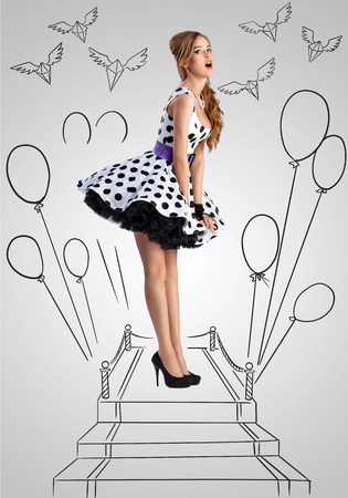 Vintage photo of a shy pin-up girl wearing a retro polka-dot dress like a fashion queen on sketchy background of a red carpet with balloons and flying diamonds.