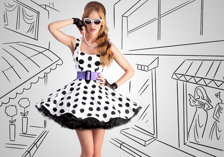 glamour woman: Vintage photo of a beautiful pin-up girl wearing a retro polka-dot dress and sunglasses on sketchy of a shopping street. Stock Photo