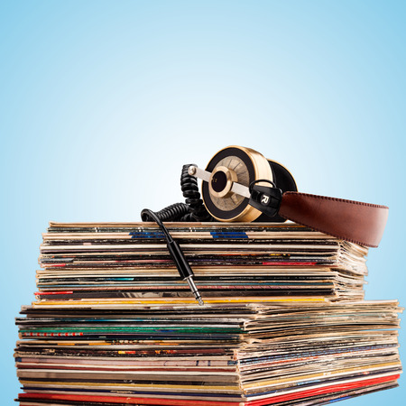 Retro headphones for professional audio with vintage vinyl records.