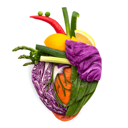 vitamins: A healthy human heart made of fruits and vegetables as a food concept of smart eating.