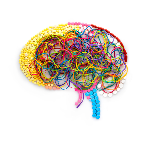hormones: Creative concept of a human brain made of drugs, pills and colorful rubber bands as a memory illustration.
