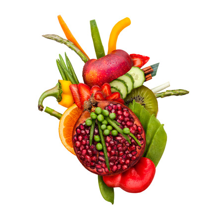 Healthy food concept of a human heart made of fruits and vegs that reduce death risk, isolated on white.