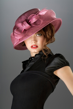 A portraot of a vintage sexy lady wearing black dress and colored hat.