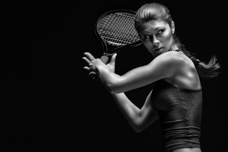 ready: A portrait of a tennis player with a racket.