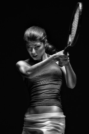 tennis racquet: A portrait of a tennis player with a racket.