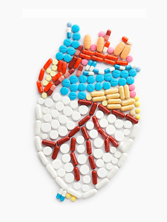 painkiller: Drugs and pills in the shape of a human heart.