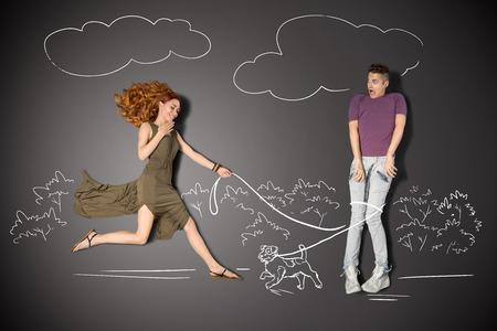 幸せなバレンタイン チョーク図面背景のロマンチックなカップルの物語のコンセプトが大好きです。男性かわいい子犬でつないに陥れた。