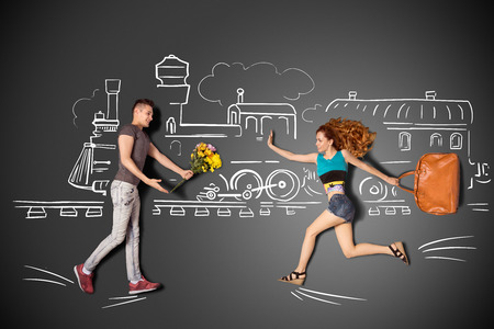 幸せなバレンタイン チョーク図面背景に駅でロマンチックなカップルの会議の物語のコンセプトが大好きです。 写真素材