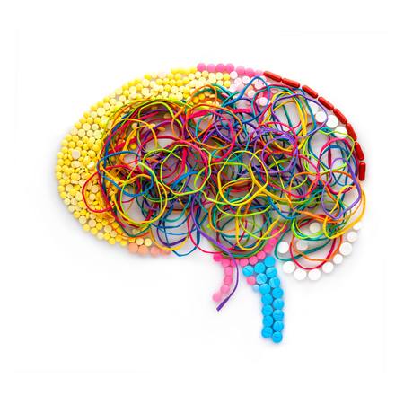 elastic band: Creative concept of a human brain made of drugs, pills and colorful rubber bands as a memory illustration.