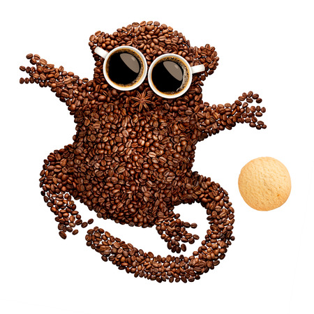 oatmeal cookie: A funny tarsier made of roasted coffee beans, two cups and star anise with an oatmeal cookie, isolated on white. Stock Photo