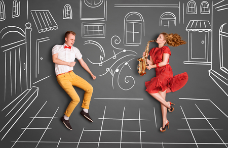 two story: Love story concept of a romantic couple against chalk drawings background. Woman playing saxophone on city streets for her lover.