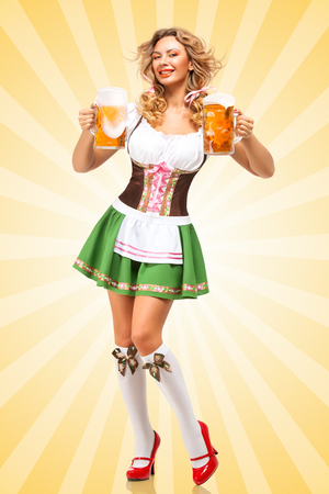 Beautiful sexy Oktoberfest woman wearing a traditional Bavarian dress dirndl serving two beer mugs on colorful abstract cartoon style background and smiling.