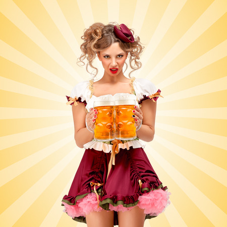 Beautiful sexy Oktoberfest waitress, wearing a traditional Bavarian dress dirndl, serving two big beer mugs in a tavern on colorful abstract cartoon style background.
