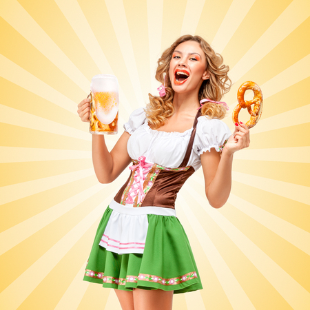 to laugh: Sexy Oktoberfest waitress wearing a traditional Bavarian dress dirndl holding a pretzel and beer mug and laughing on colorful abstract cartoon style background. Stock Photo
