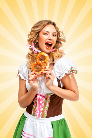 nude girl: Beautiful sexy Oktoberfest woman wearing a traditional Bavarian dress dirndl holding a pretzel in hands on colorful abstract cartoon style background.