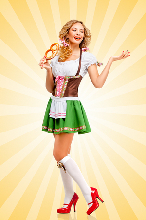 salty: Beautiful sexy Oktoberfest woman wearing a traditional Bavarian dress dirndl posing with a soft salty pretzel on colorful abstract cartoon style background.