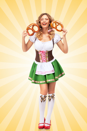 sexy party girl: Beautiful sexy Oktoberfest woman wearing a traditional Bavarian dress dirndl laughing happily and holding two pretzels in hands on colorful abstract cartoon style background.