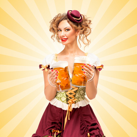 thirst: Beautiful sexy Oktoberfest waitress, wearing a traditional Bavarian dress dirndl, serving two big beer mugs in a tavern and licking her lips on colorful abstract cartoon style background.
