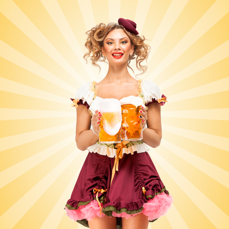 licking: Beautiful sexy Oktoberfest waitress, wearing a traditional Bavarian dress dirndl, serving two big beer mugs in a tavern and licking her lips on colorful abstract cartoon style background.