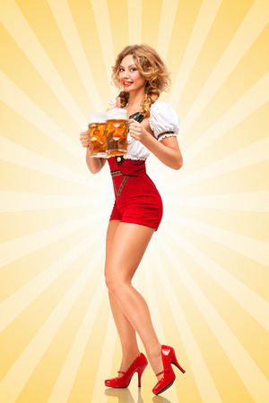 Beautiful tempting sexy woman wearing red jumper shorts with suspenders as traditional dirndl, serving two beer mugs with smile on colorful abstract cartoon style background.