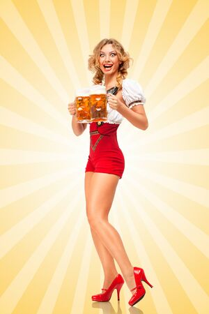 party girl: Beautiful excited sexy woman wearing red jumper shorts with suspenders as traditional dirndl, serving two beer mugs with smile on colorful abstract cartoon style background.