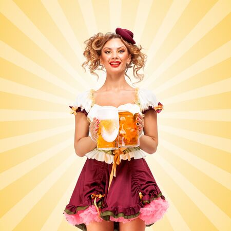 tavern: Beautiful sexy Oktoberfest waitress, wearing a traditional Bavarian dress dirndl, serving two big beer mugs in a tavern and smiling on colorful abstract cartoon style background.