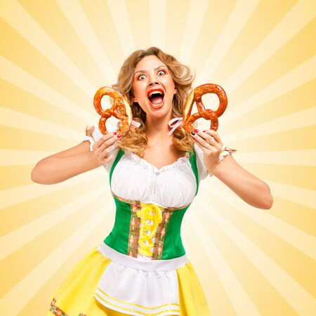 clothes cartoon: Beautiful screaming sexy Oktoberfest woman wearing a traditional Bavarian dress dirndl holding two pretzels, and making grimaces on colorful abstract cartoon style background.