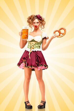 grimaces: Beautiful sexy Oktoberfest waitress wearing a traditional Bavarian dress dirndl holding a pretzel and beer mug, and making grimaces of contempt on colorful abstract cartoon style background.