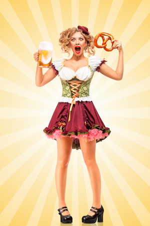 grimace: Beautiful shocked Oktoberfest waitress wearing a traditional Bavarian dress dirndl holding a pretzel and beer mug, and making grimaces on colorful abstract cartoon style background.
