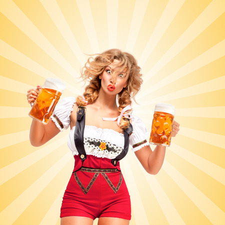 Beautiful surprised sexy woman wearing red jumper shorts with suspenders as traditional dirndl, holding two beer mugs on colorful abstract cartoon style background.