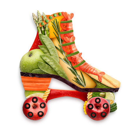 summer sport: Healthy food concept of quad roller skates made of fresh vegetables full of vitamins, isolated on white. Stock Photo