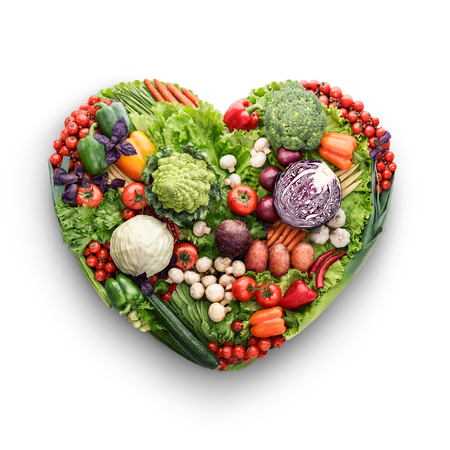 mix fruit: Healthy food concept of a human heart made of vegetable and fruit mix that reduce death risk, isolated on white.