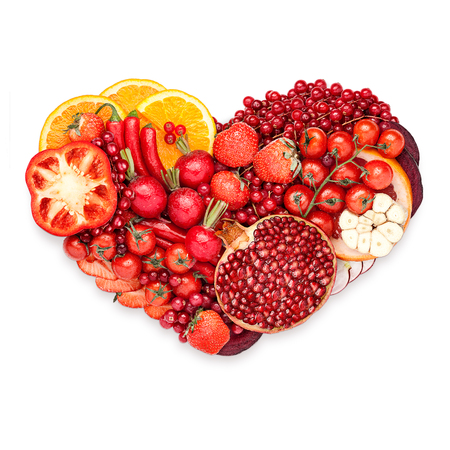 food concept: Healthy food concept of a human heart made of vegetable and fruit mix that reduce death risk, isolated on white.