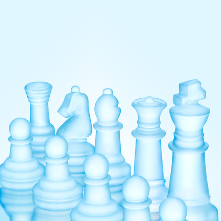 outwit: Strategy and tactics concept; icy frosted chess figures standing in a row ready for game