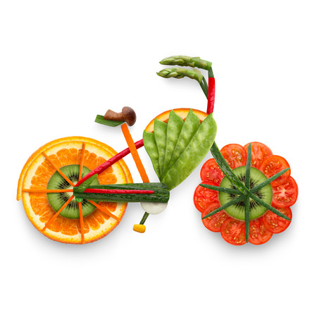 summer sport: Healthy food concept of an electric bicycle in detail made of fresh vegetables and fruits full of vitamins, isolated on white.