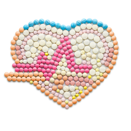 Creative medicine and healthcare concept made of drugs and pills, isolated on white. ECG, a human heart with a heartbeat line. Stock Photo
