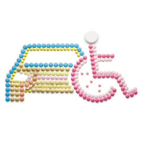 healthcare and medicine: Creative medicine and healthcare concept made of drugs and pills, isolated on white. Abstract wheelchair invalid symbol, disabled person in a wheelchair in front of a car.