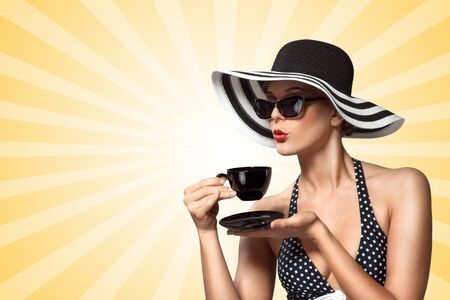 cup  coffee: A creative vintage photo of a beautiful pin-up girl drinking tea and showing good table manners on colorful abstract cartoon style background.