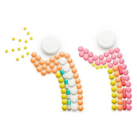 spreading: Creative health concept made of drugs and pills, isolated on white. A person that caught a cold, sneezing and spreading disease while standing near another person. Stock Photo