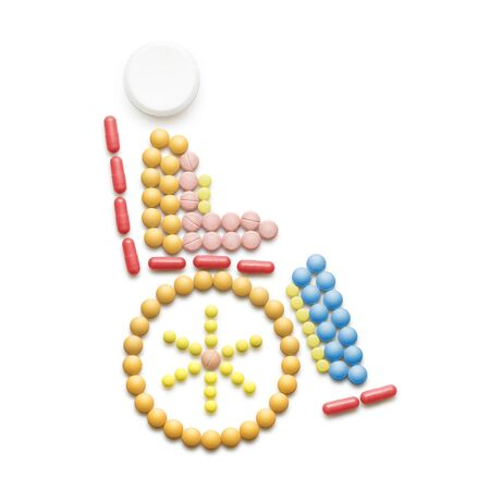medicine wheel: Creative medicine and healthcare concept made of drugs and pills, isolated on white. Abstract wheelchair invalid symbol, disabled person sitting in a wheelchair. Stock Photo
