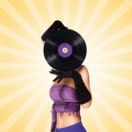 woman behind: Colorful photo of a sexy girl, hiding behind a purple LP microgroove vinyl record on colorful abstract cartoon style background.