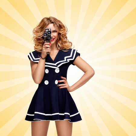 sailor girl: Pin-up sailor girl with a vintage cinema 8 mm camera shooting a movie on cartoon style background.