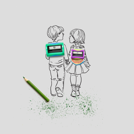 sharpening: Creative concept photo of two sharpeners and a pencil with illustrated pupils holding hands on grey  background.