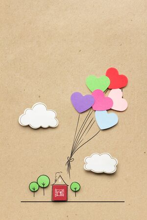 Creative valentines concept photo of hearts as balloons on brown background. Banco de Imagens
