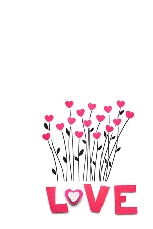 Creative valentines concept photo of hearts as flowers made of paper with love sing on white background.
