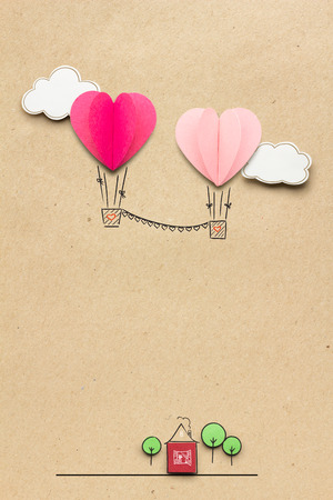 balloon background: Creative valentines concept photo of clouds and hearts as aerostats on brown background. Stock Photo