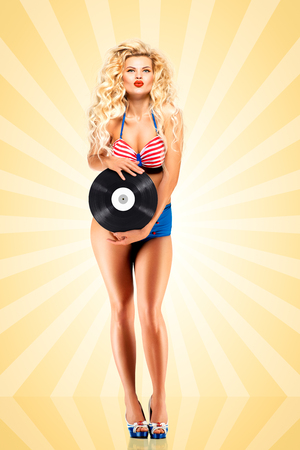 melomaniac: Beautiful pinup bikini model, holding an LP vinyl record on colorful abstract cartoon style background.