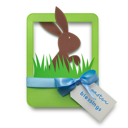 photo: Creative easter concept photo of a rabbit in a frame made of paper on white background.