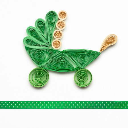 Creative photo of quilling go cart  made of paper on white background. Stock Photo