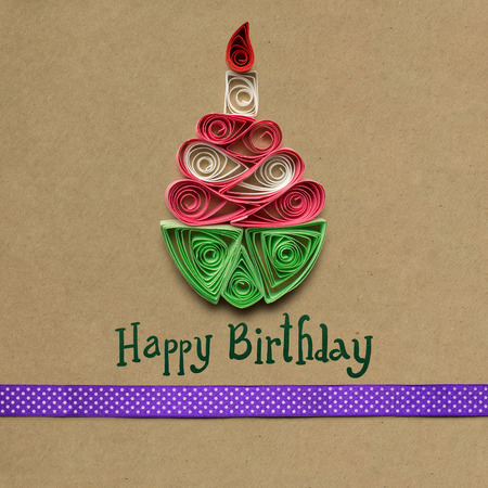 Creative concept photo of quilling birthday cake made of paper on brown background. Stock Photo - 73547004